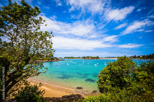 Small bay with boats at the emerald coast in Brittany, France