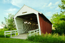 The Imes Covered Bridge Leaning To The Left In Madison County, Iowa, Three Quarter View With Trusses, Cross Beams, White Railing, Green Trees, Blue Skies And White Clouds Royalty Free Stock Photo