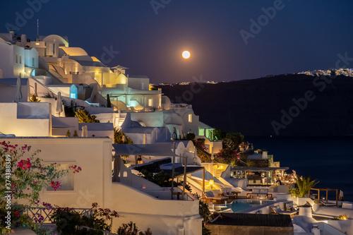 Obraz moonrise at evening at Oia Santorini Greece Europe - fototapety do salonu