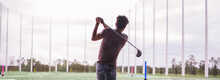 Playing Golf On A Driving Range