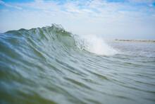 An Azure Sea Wave With A White Crest Runs Ashore.