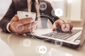 Obraz na płótnie Canvas Human hands working on a modern laptop and smartphone