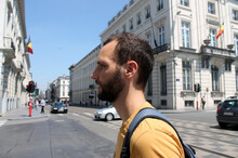 Young Man In A Yellow Shirt Crosses The Road In The Center Of Brussels
