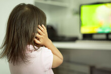 Little Kid Covering Her Ears, Frightened From Loud Noise From TV. Autism.