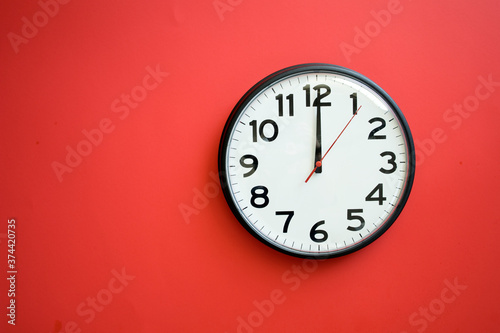 Fototapeta Wall Clock on a Red Background