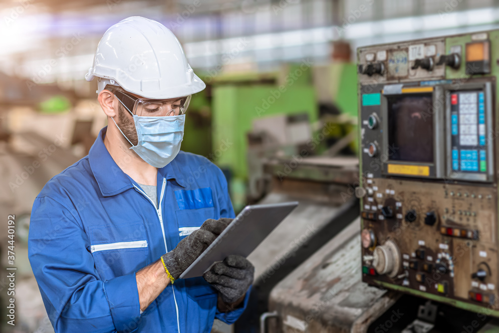 Fototapeta Worker wearing face shield or disposable face mask during working service in factory to prevent Coronavirus(Covid-19) or air dust pollution in factory.