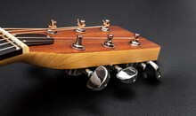 Head Of Acoustic Guitar  On Bl...