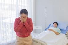 An Asian Woman Cries And Sorro...