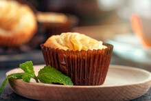 Rice Flour Cupcake With Apple Slices. The Cupcake Lies On A Wooden Plate. Apple Filling..Delicious Homemade Cupcake. Baking For Tea And A Cafe.