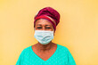 canvas print picture - Senior african woman wearing face protective mask during coronavirus outbreak