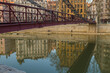 Bridge over the river in Lyon with building reflections on the water
