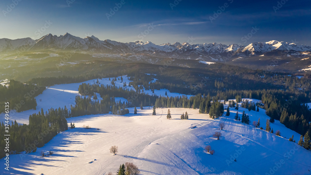 Tatra mountains at sunrise in winter, aerial view