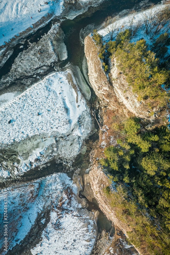 Frozen Bialka river and Kramnica rock in winter, aerial view