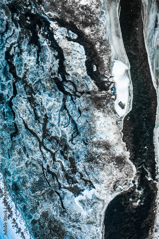 Aerial view of melting ice on Bialka river in winter