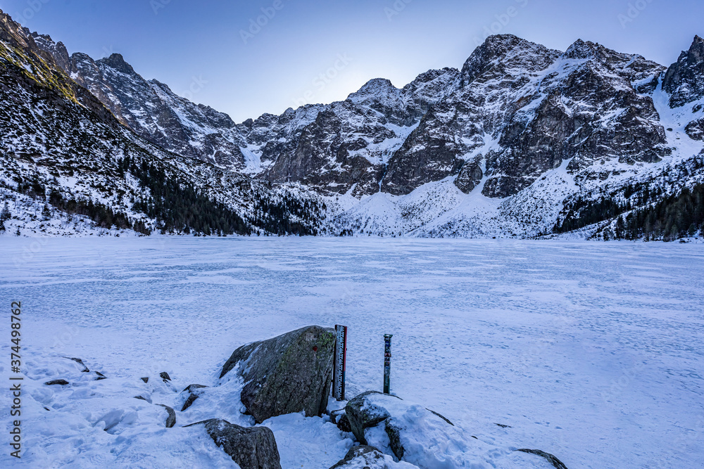 Covered by snow Morskie Oko lake in Tatra Mountain