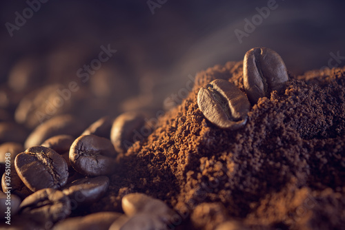 Tela Coffee beans on a pile of finely ground coffee.