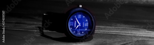 Dhaka,Bangladesh-August 29,2020 : Hand watch neon light effect circle black analog adidas brand watch with wooden background Canvas Print