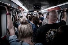 Pasengers Ride The Crowded Und...