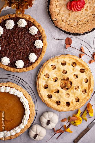 Fotografie, Obraz Traditional fall pies, apple, pumpkin and pecan pie ooverhead