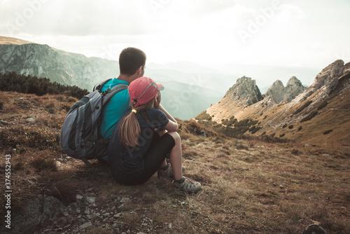 Obraz father and son travel hiking in mountains, family tourism, Tatra Mountains national park in Zakopane, Poland - fototapety do salonu