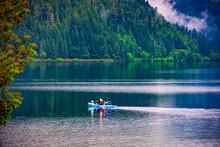 Canoe In Foggy Lake