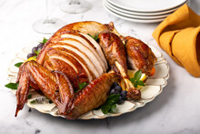 Carved Roasted Turkey For The Calebration Thanksgiving Or Christmas Dinner On A Plate