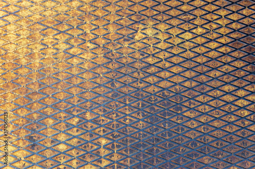 Photo metal grunge background covered with abraded yellow paint, rust