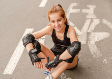 Young Girl In Rollerblades On ...