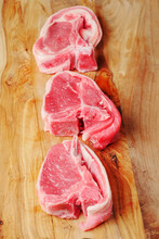 Three Uncooked Lamb Loin Cutle...