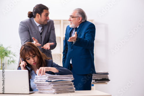 Two male and one female employees working in the office Wallpaper Mural