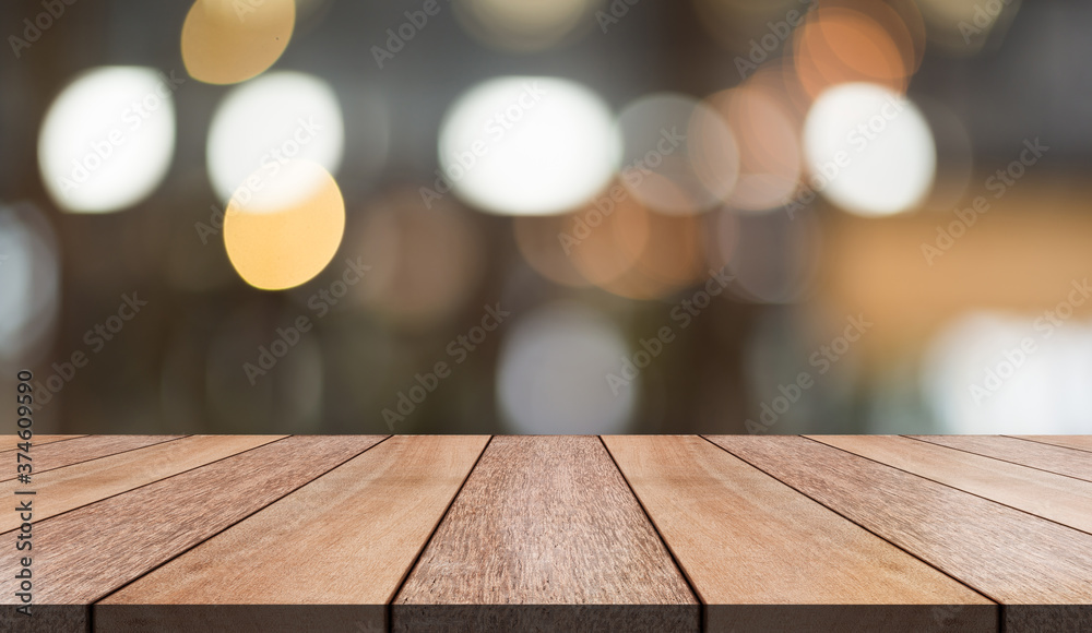 Fototapeta Empty wooden table top with lights bokeh on blur restaurant background