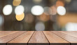 Empty wooden table top with lights bokeh on blur restaurant background