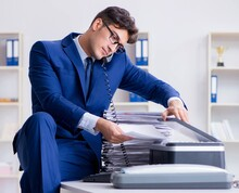 Businessman Making Copies In C...