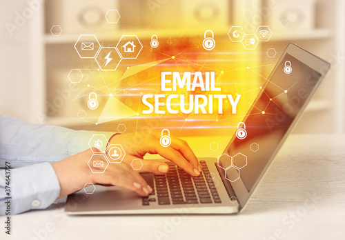 Photo EMAIL SECURITY inscription on laptop, internet security and data protection conc