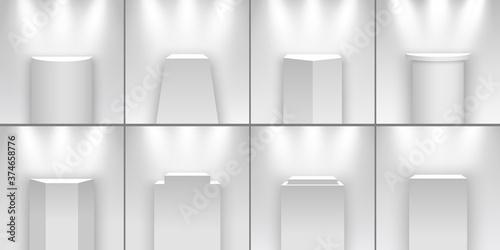 Vászonkép Set of white exhibition stands illuminated by spotlights