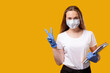 canvas print picture - School reopen. Quarantine class. Happy female student in protective face mask gloves showing victory sign isolated on bright yellow copy space. COVID-19 pandemic. New normal.