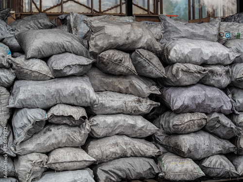pile of bags of soil and coal, agriculture, Soil bag stack in warehouse Fototapeta