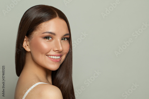 Pretty model woman with clear skin and long healthy straight hair Fotobehang