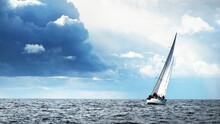 Sailing Yacht Regatta. Modern Sailboat Racing Through The Waves. Dramatic Sky Before The Thunderstorm. Terrific Cloudscape. North Germany, Kiel