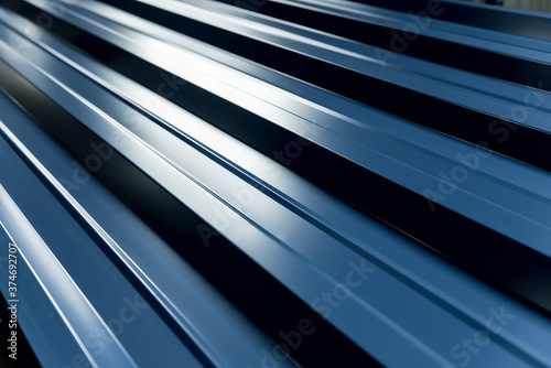 Fotografija Blue metallic roof tiles background with drops of water.
