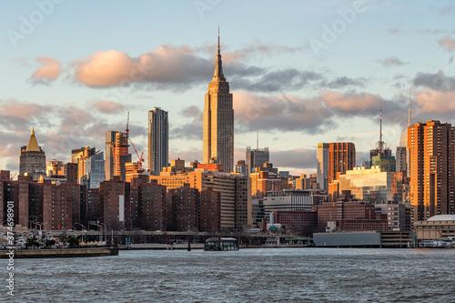 Fotografie, Obraz Empire State Building and Manhattan skyline at sunset, New York City, USA