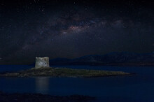 Ancient Tower On The Coast In Sardinia At Night