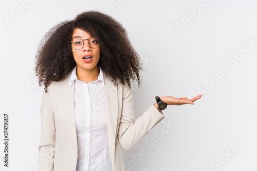 Young african american business woman impressed holding copy space on palm Tapéta, Fotótapéta
