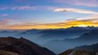 Panorama on the Alps at sunset. Stunning colorful sky, high altitude mountain peaks