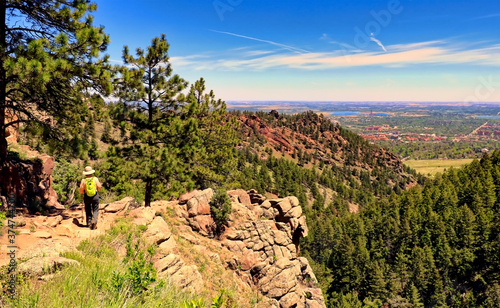 Hiker on Boulder, Colorado's Gregory Canyon Trail, with the rooftops of the University of Colorado in the background Canvas Print