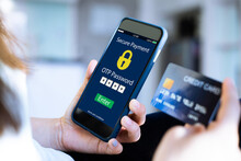 Secure Payment OTP PASSWORD CONCEPT.female Hands Using Mobile Phone And Holding Credit Card