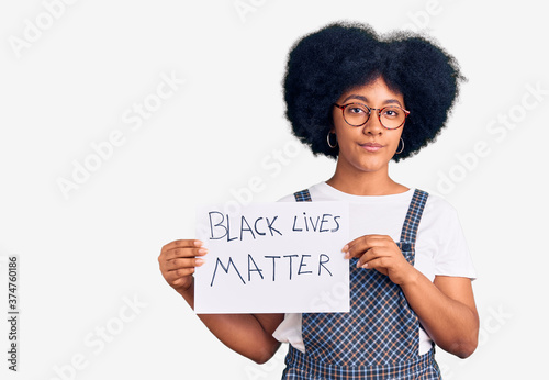 Young african american girl holding black lives matter banner thinking attitude Canvas Print