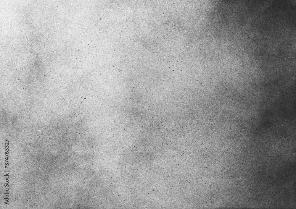Fototapeta Vintage black and white noise texture. Abstract splattered gradient background for vignette.