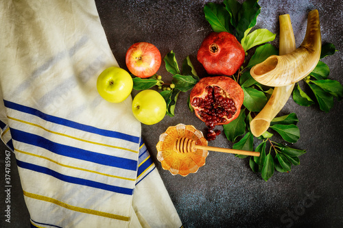 Fototapeta Shofar and food with talit for jewish holiday Rosh Hashanah.