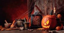 Halloween Pumpkins On An Old Wooden Background.